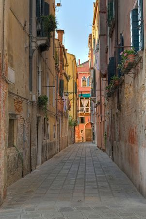 Typical street in Venice - Italy, with beautifully colored houses photo