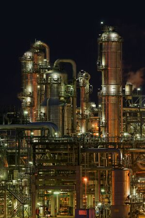 Intimate details of a chemical production facility at night photo