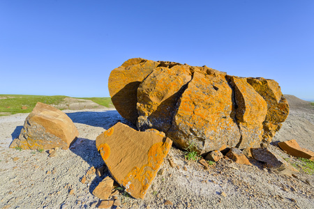 erode: Orange weathered rock, Red Rock Coulee, Alberta, Canada