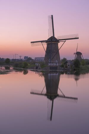 Historic windmills at Kinderdijk, The Netherlands, in beautiful twilight. 写真素材