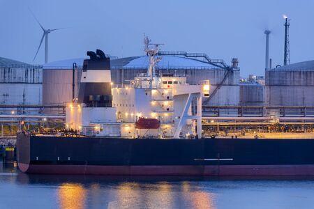 Liquid Natural Gas storage tanks and tanker at dusk, Port of Rotterdam 写真素材