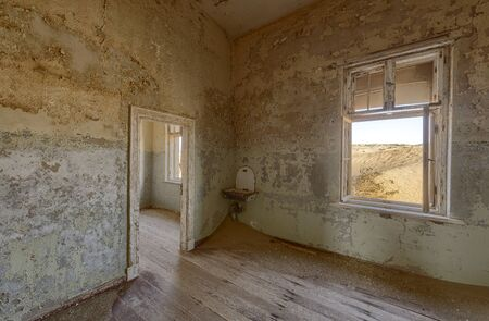 View from a room in a deserted building in hot Namibian desert. 写真素材