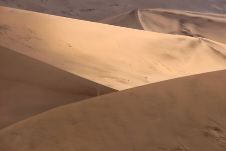 Colorful sand dunes with beautiful patterns and ripples in the Namib-Naukluft National Park, Namibia 版權商用圖片 - 131734855