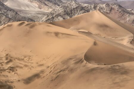 Colorful sand dunes with beautiful patterns and ripples in the Namib-Naukluft National Park, Namibia 版權商用圖片 - 131734421