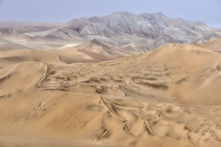 Colorful sand dunes with beautiful patterns and ripples in the Namib-Naukluft National Park, Namibia