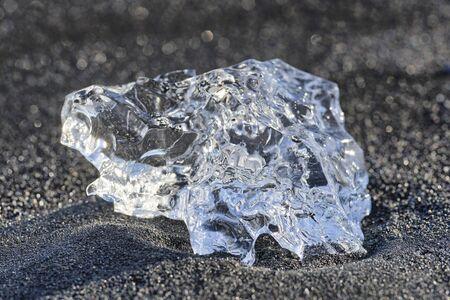 Ice crystal on black lava beach, Iceland