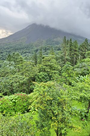Arenal Volcano in clouds, Costa Rica Stock Photo