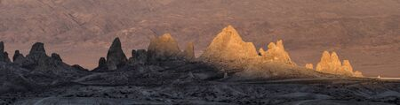 Sunlight fighting the shadows on the Trona Pinnacles in the Sears Valley