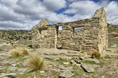 Old deserted miners cabin in the mountains near Bendigo, New Zealand.