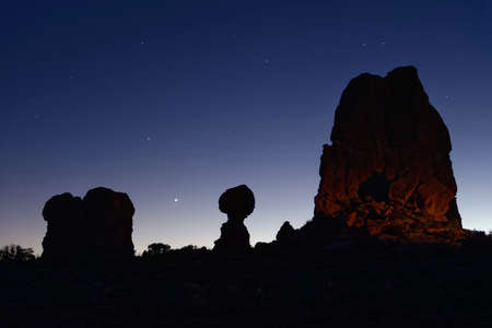 Balanced Rock under the stars and clear blue night sky, Arches National Park, Utah.