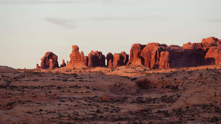 Warm sunset light on ancient sand stone spiers, Arches National Park, Utah.