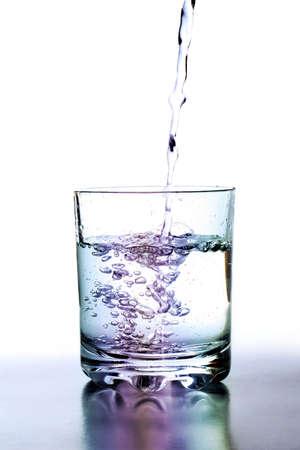 shot of liquid falling into a glass photo