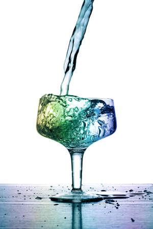ecard: shot of liquid falling into a full glass