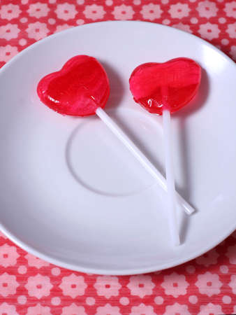 two lollipops on a plate photo