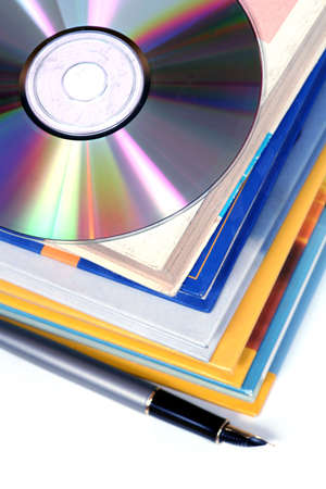 replaces: digital information - one disk replaces a pile of books Stock Photo