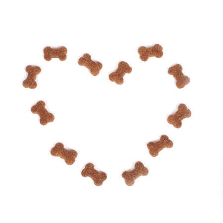 bones: heart made of dog food isolated on white