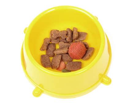 bowl of dog food isolated on white photo
