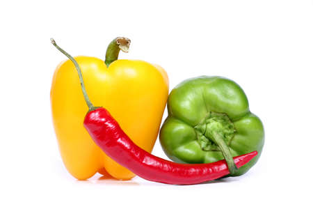photo of three peppers isolated on white background.