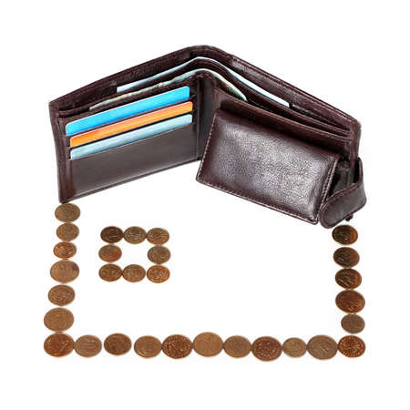 insure: metaphor of mortgage - brown wallet with cards and coins arranged on house isolated on white background Stock Photo