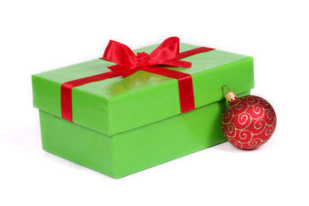 green wrapped gift and red christmas ball Stock Photo