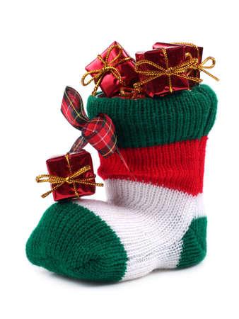saint nick: Christmas stocking full of presents Stock Photo