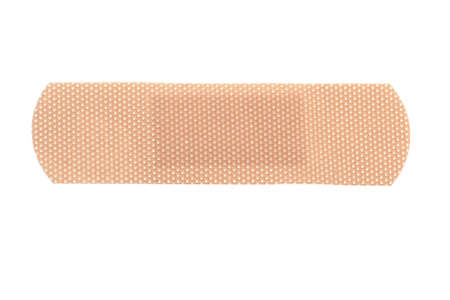 macro of a skin toned bandage isolated on white background Stock Photo