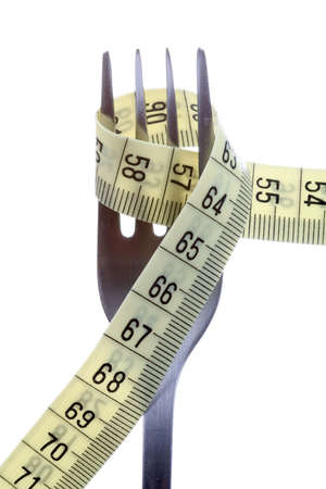 measuring tape wrapped around fork - weight loss metaphor