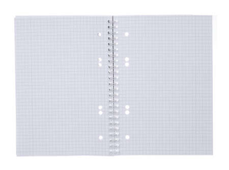 an open spiral bound notebook with grid paper