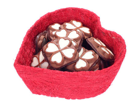 Close up of an open heart shaped gift box with cookies (isolated on white background) photo