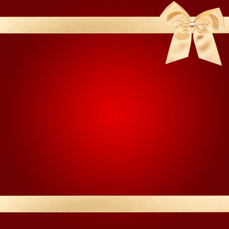 Gold Christmas bow on square red card Stock Photo - 6241580
