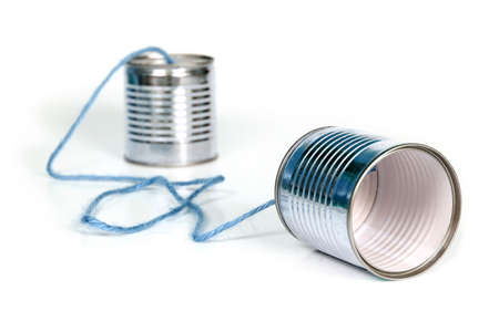 ancient communication - cans connected by blue string Stock Photo