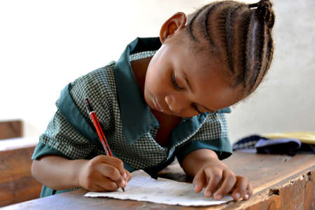 kids writing: African Student Writing - Schoolgirl