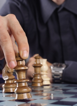 Businessman playing chess game, strategy concept photo