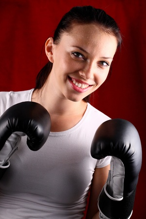 Portrait of a young woman wearing boxing gloves photo