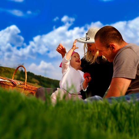 Happy family having a picnic in the park photo