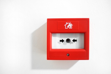 Fire alarm security button isolated on white Stock Photo