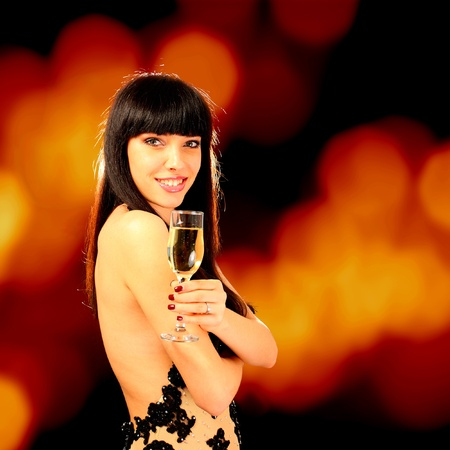 Sexy happy woman with champagne glass, back light photo