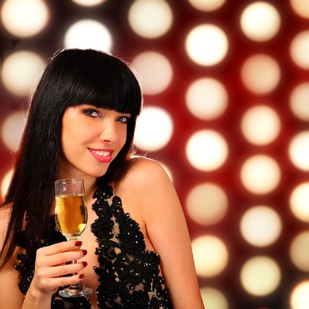 Portrait of a young woman holding a champagne glass photo