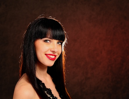 Portrait of a young woman wearing a black dress photo