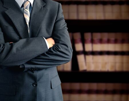legal law: Businessman wearing a suit in front of a bookcase