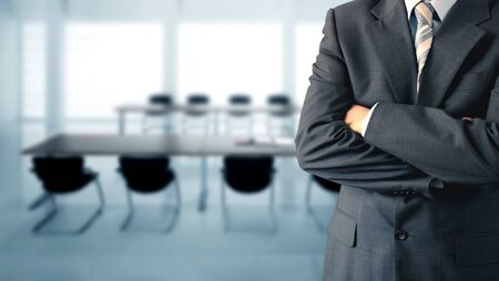 adviser: Businessman standing in a conference room