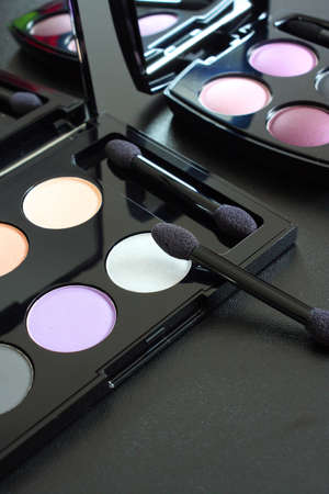 Colorful eyeshadow palettes with makeup brush, nobody photo