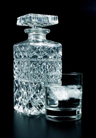 vodka bottle: Crystal bottle and glass on black background Stock Photo