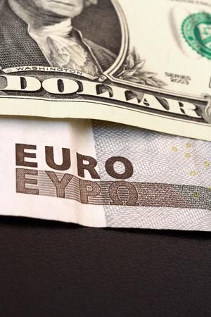 two dollar bill: Euro and dollar bill macro, black background