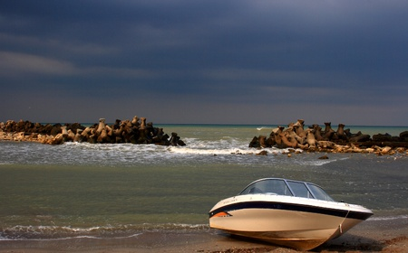 Power boat on an empty beach, nobody photo