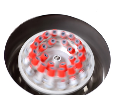 Blood samples placed in a spinning centrifuge; motion blur photo