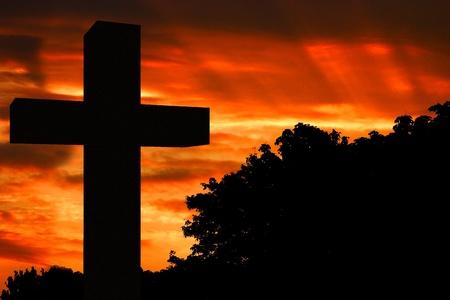 black jesus: Christian cross silhouette against sunset sky