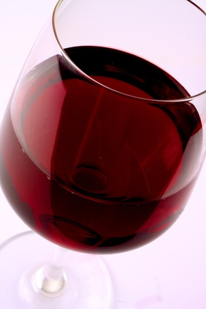 Red wine in a wine glass, white background photo