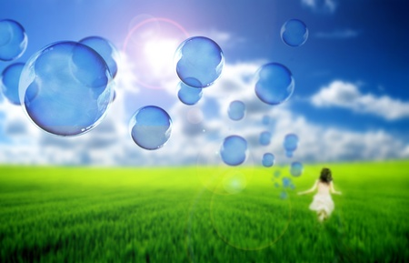 Child playing with soap bubbles photo