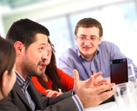 two women talking: Businessman talking at a meeting